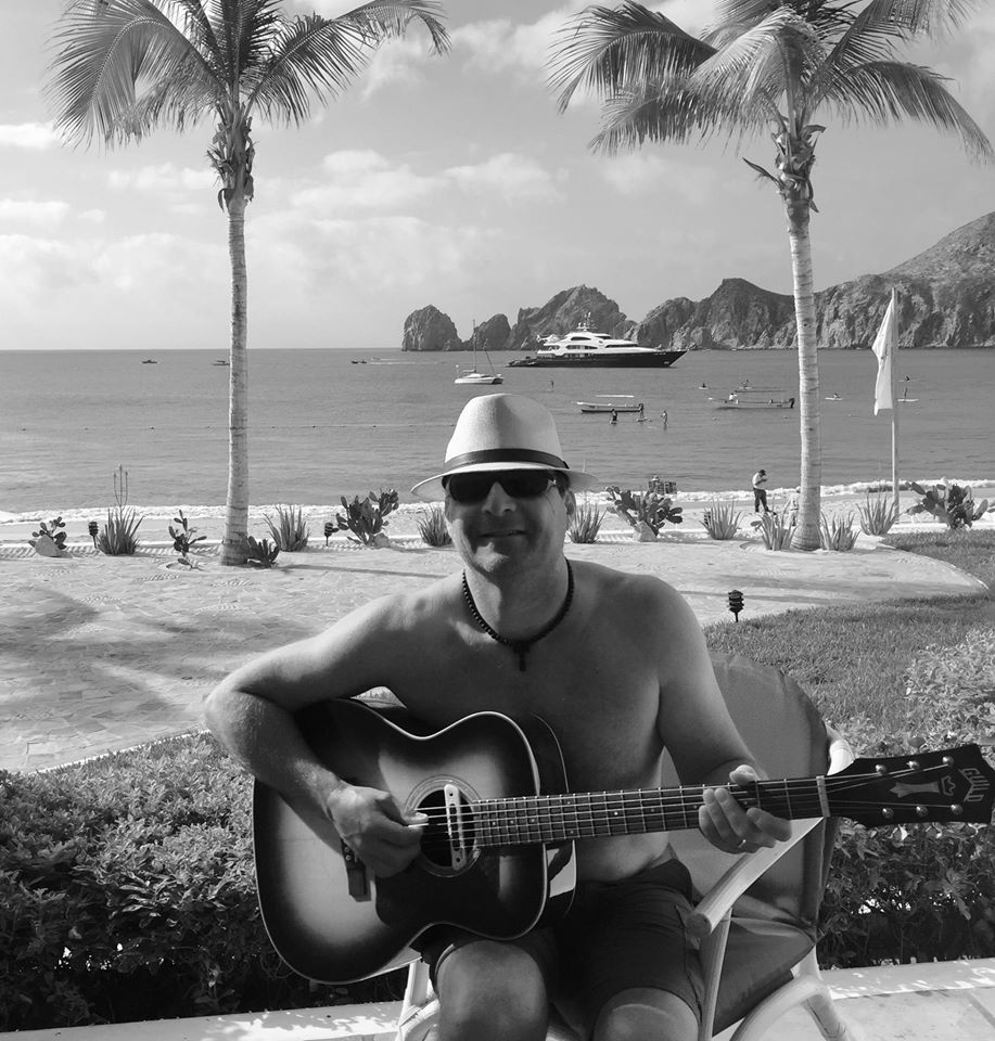 Guitarist Tommy Fedak on the beach in Cabo San Lucas